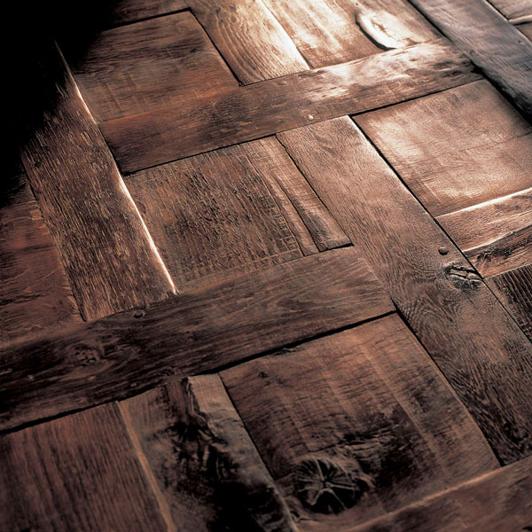 Reclaimed 300-year-old French oak laid in a parquet de Chantilly pattern to individual specifications
