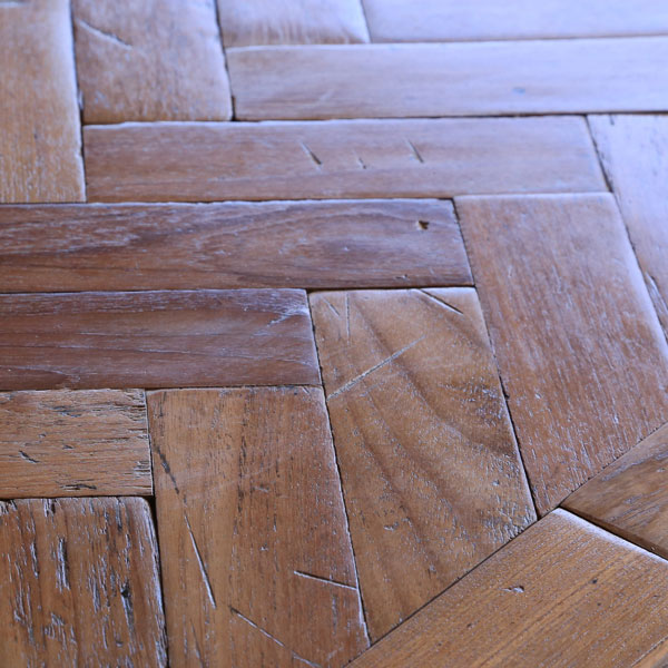 Reclaimed parquet woodblock. Burmese teak laid in single herringbone pattern. Hand DA sanded for a vintage textured floor