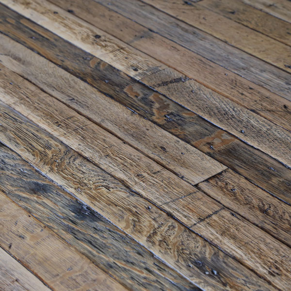 Reclaimed and machined floorboards produce a soft, subtle and timeworn floor